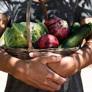young-man-with-a-basket-full-of-vegetables-picture-id961308290 copy
